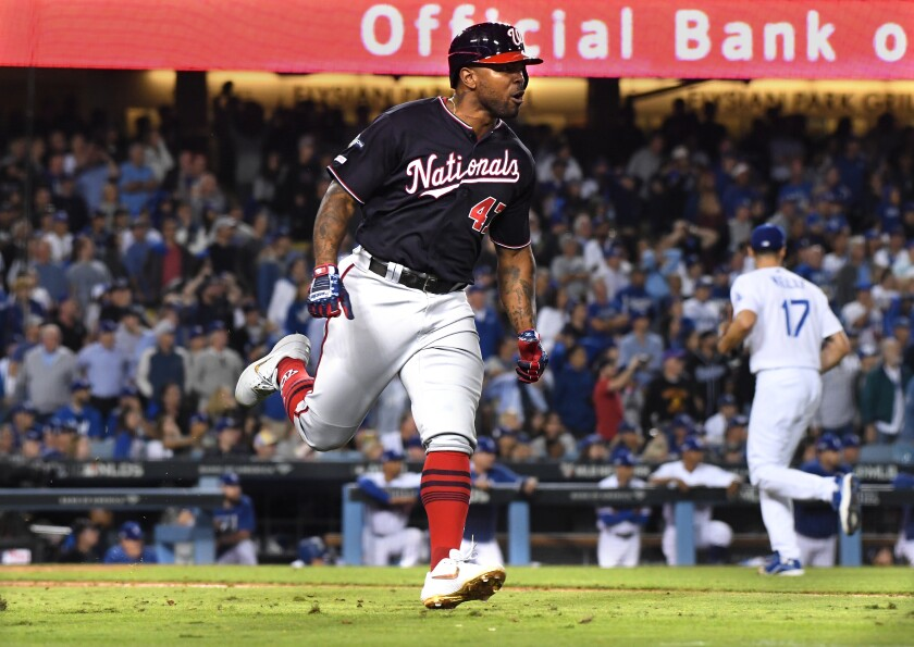 Nationals first baseman Howie Kendrick celebrates his grand slam in the 10th inning against the Dodgers on Wednesday.