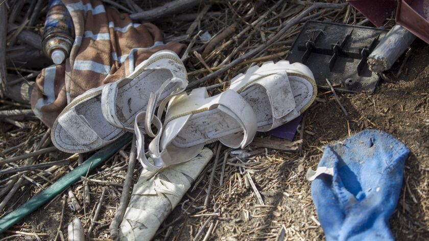 Shoes and other items lie on the ground at a homeless encampment in Costa Mesa in October 2016.