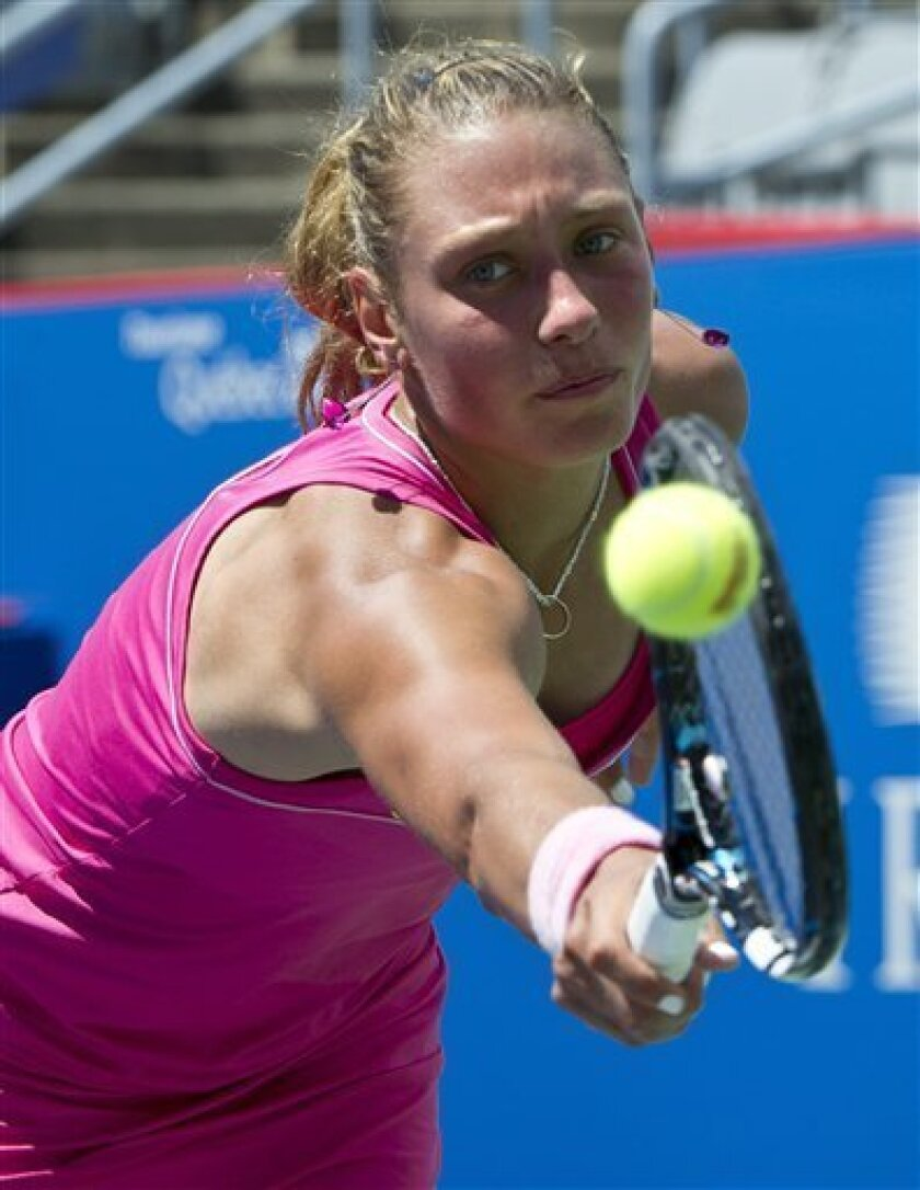 Yanina Wickmayer, of  Belgium,makes a return against Roberta Vinci, of Italy, during first round of play at the Rogers Cup tennis tournament, Tuesday, Aug. 7, 2012, in Montreal. (AP Photo/The Canadian Press, Paul Chiasson)