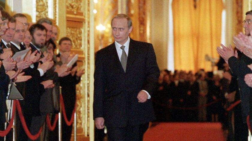 Russian President Vladimir Putin makes his way down a red carpet after an inauguration ceremony in Moscow's Kremlin on May 7, 2000.