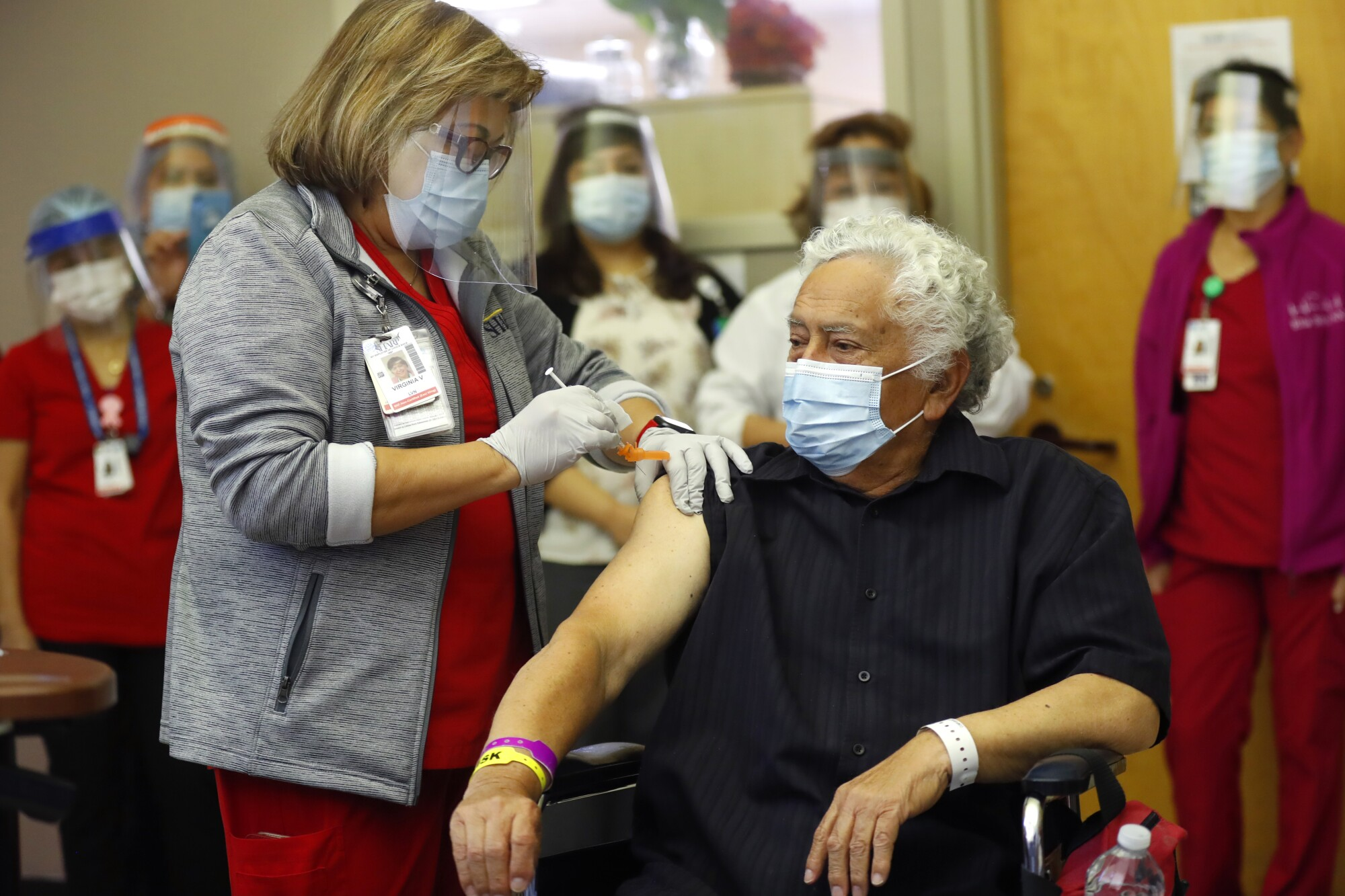 Nursing home staff receive a COVID-19 vaccine at Avocado Post Acute.