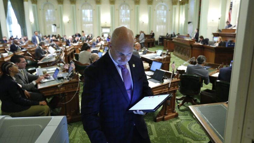 Assemblyman Heath Flora (R-Ripon) looks up a bill on an Assembly computer at the Capitol on Thursday. Lawmakers wrapped up their work for the year on Friday.