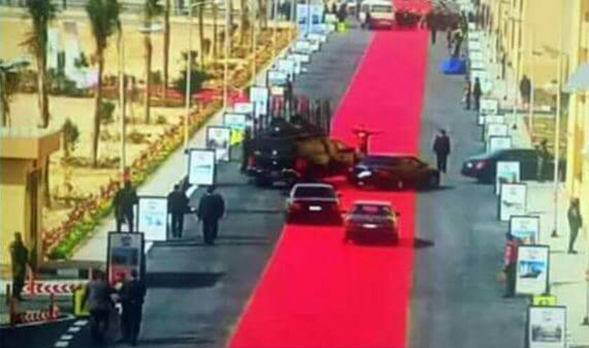 In this Saturday, Feb. 6, 2016 image taken from Egypt State TV, Egyptian President Abdel-Fattah el-Sissi's motorcade drives on a red carpet during a trip to open social housing projects in a suburb of Cairo, Egypt. Images of the giant red carpet prompted a wave of mockery on social media, and one l