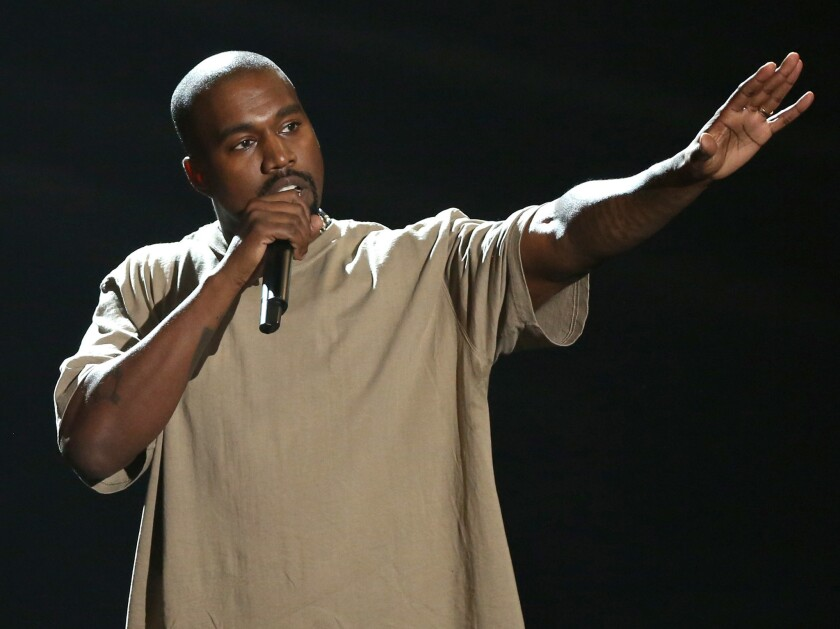 In this Sunday, Aug. 30, 2015, file photo, Kanye West accepts the video vanguard award at the MTV Video Music Awards at the Microsoft Theater in Los Angeles.