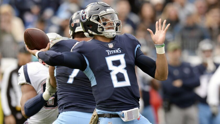 FILE - In this Nov. 11, 2018, file photo, Tennessee Titans quarterback Marcus Mariota throws a pass