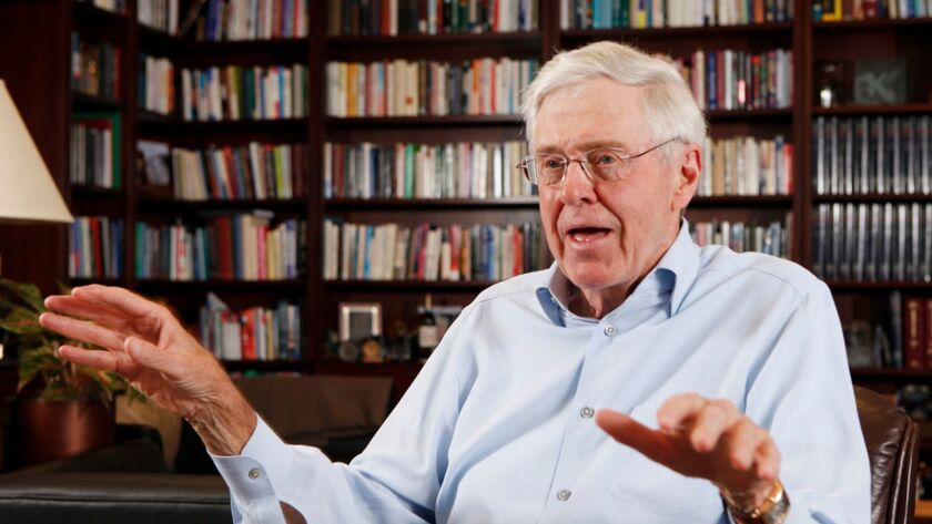 FILE - In this photo May 22, 2012 file photo, Charles Koch speaks in his office at Koch Industries i