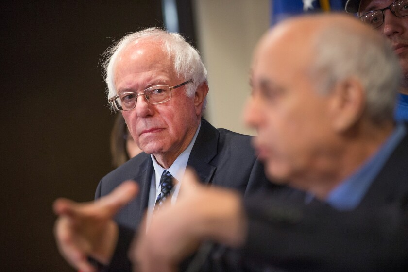 Democratic presidential candidate Bernie Sanders meets with union members in Michigan this month to discuss the effects of free-trade agreements on U.S. workers.