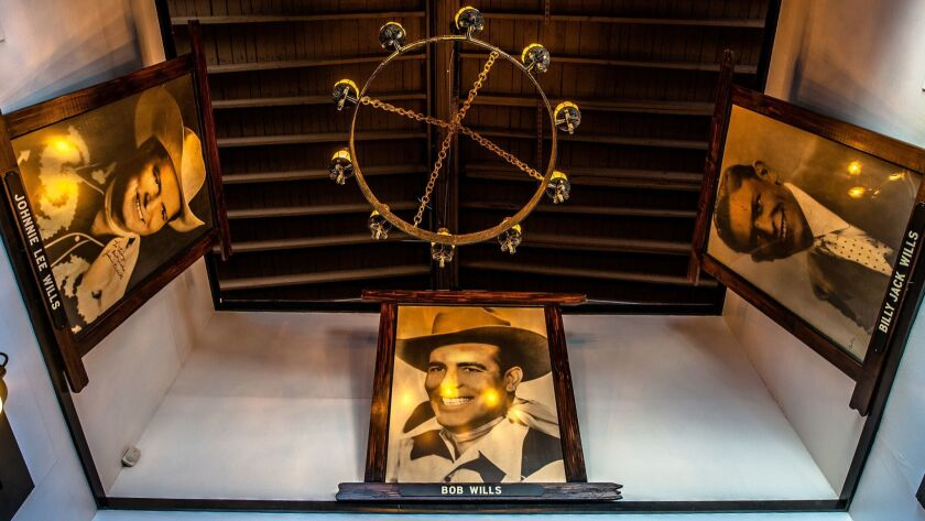 A portrait of Bob Wills, flanked by his brothers, Johnnie Lee and Billy Jack, hang in the entrance w
