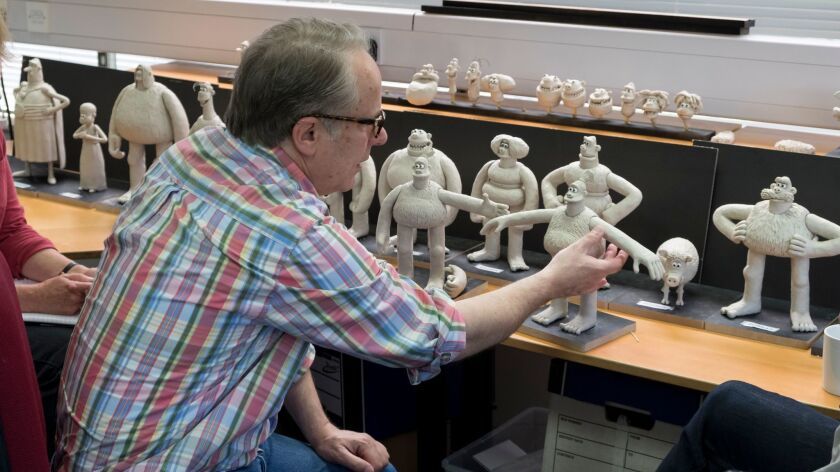 """Nick Park Director talks with the puppet making team about the character sculpts on the set of """"Earl"""