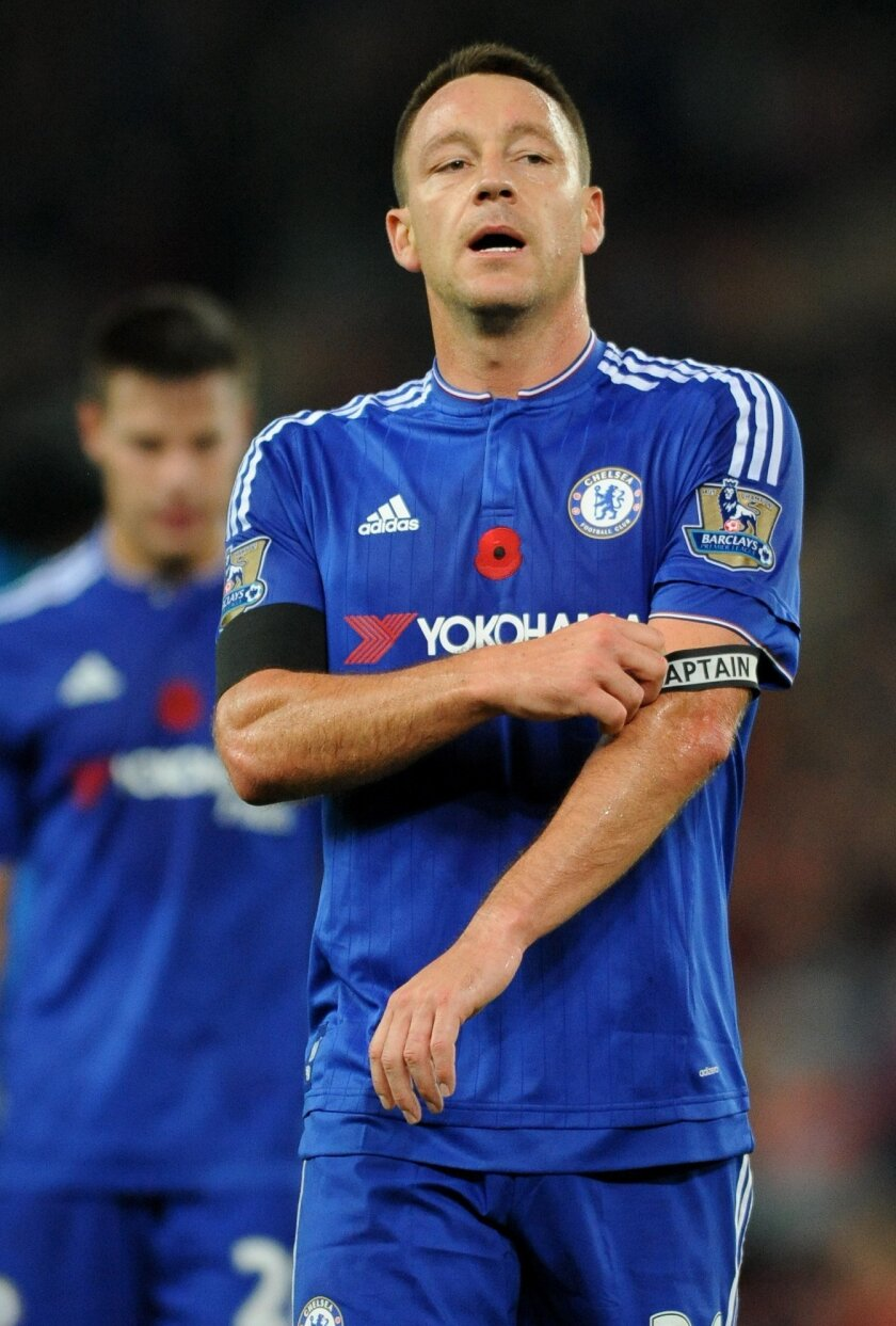 Chelsea captain John Terry removes his captain's arm band after the English Premier League soccer match between Stoke City and Chelsea at the Britannia Stadium, Stoke on Trent, England, Saturday, Nov. 7, 2015. (AP Photo/Rui Vieira)