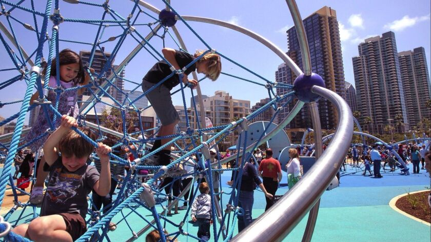 Children play on the new playground equipment adjacent to the new County of San Diego Waterfront Park.