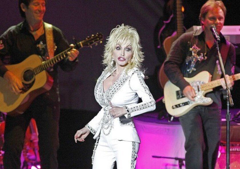 <b>'BACKWOODS BARBIE':</b> Dolly Parton girl is dressed for Vegas at the Greek.