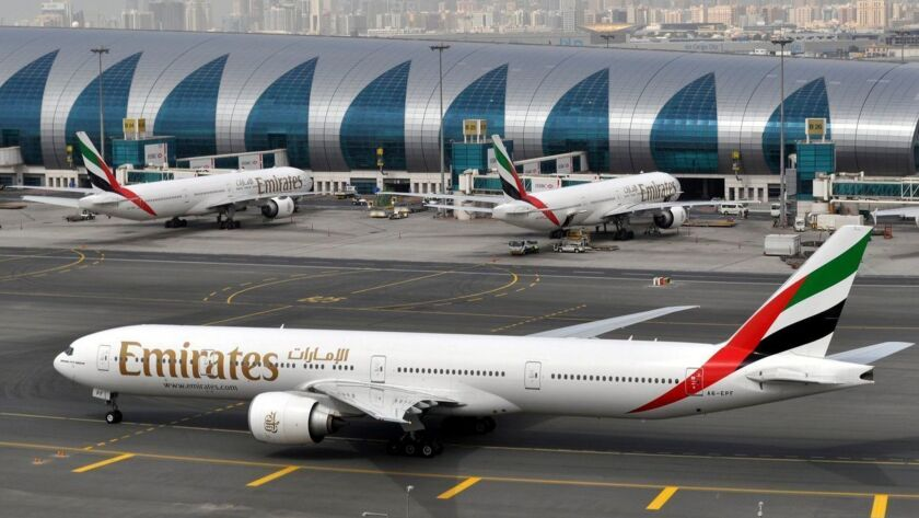 FILE - In this Wednesday, March 22, 2017, file photo, an Emirates plane taxis to a gate at Dubai Int