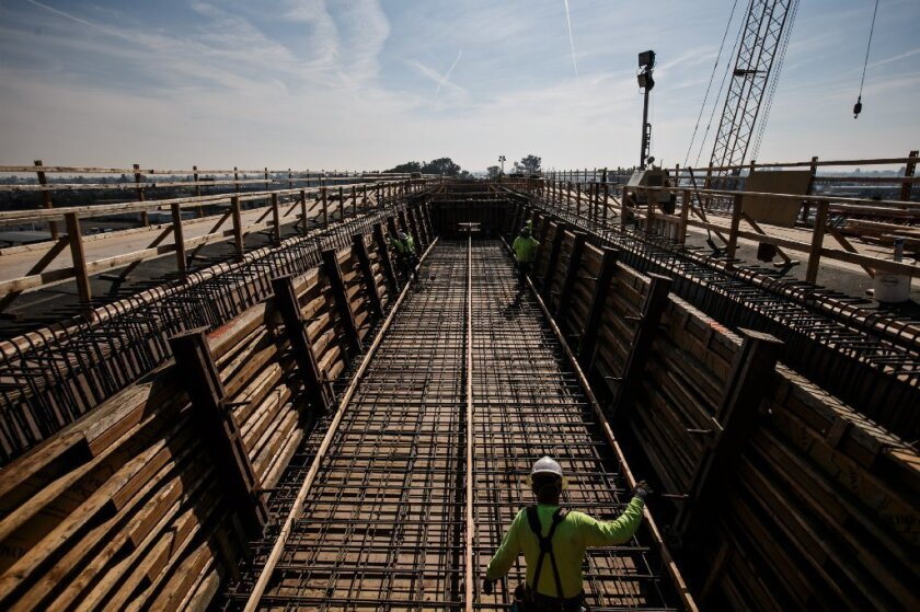 Crews work at a 3,700-foot-long viaduct that is being built for the high-speed rail line in Fresno.