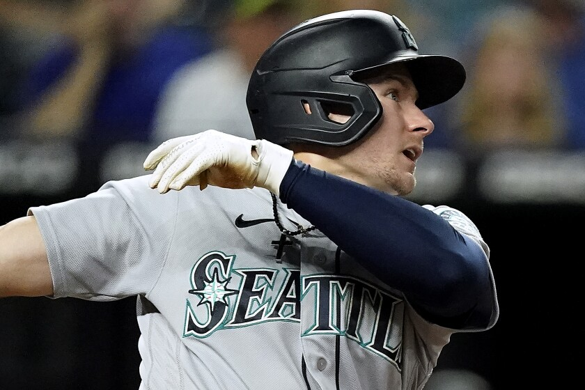 Seattle Mariners' Jarred Kelenic watches his two-run home run during the fourth inning of a baseball game against the Kansas City Royals Friday, Sept. 17, 2021, in Kansas City, Mo. (AP Photo/Charlie Riedel)