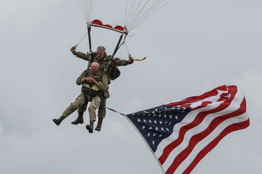 WW II vet Tom Rice (bottom) took part in a parachute drop over Carentan, Normandy, as part of D-Day's 75th anniversary.