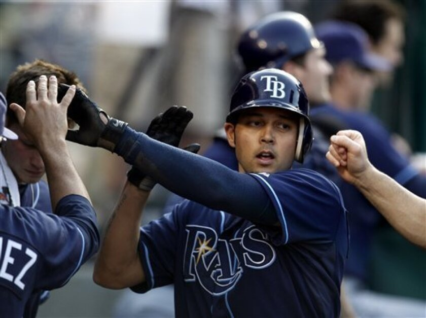 Tampa Bay Rays' Jason Bartlett celebrates in the dugout after scoring on a passed ball during the fifth inning of a baseball game against the Los Angeles Angels in Anaheim, Calif., Wednesday, May 12, 2010. (AP Photo/Chris Carlson)