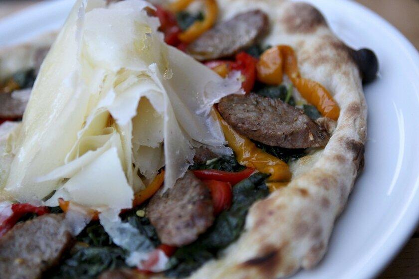 Monello's signature pizza meets Societe's signature brews