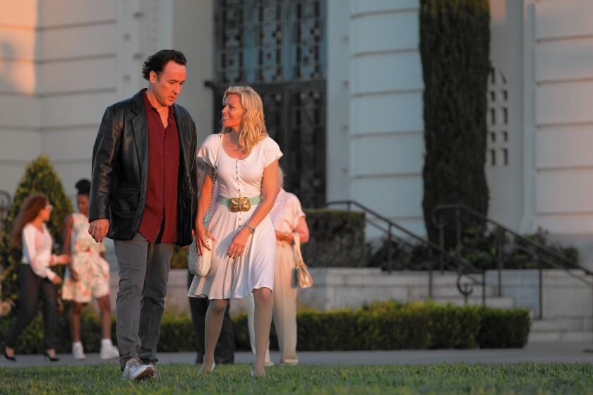 "John Cusack and Elizabeth Banks in ""Love & Mercy."""