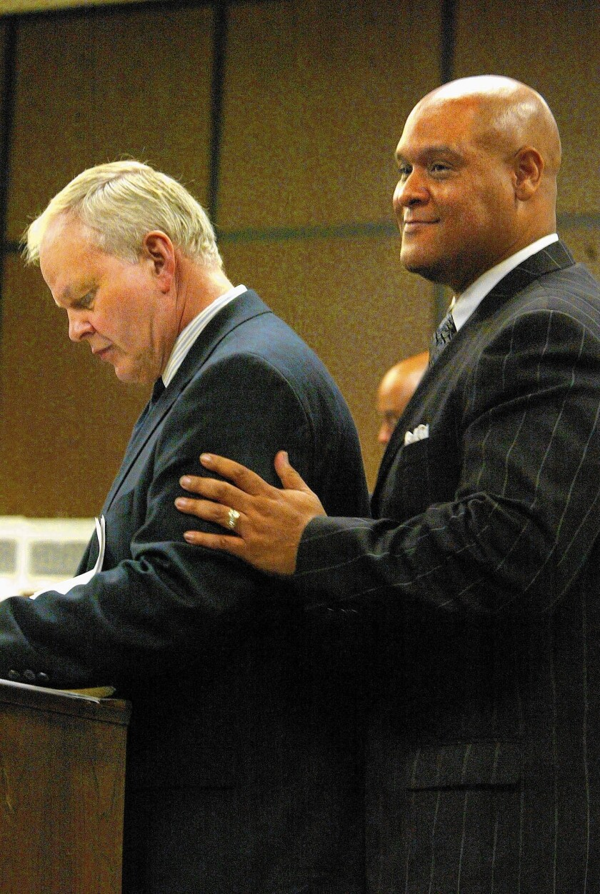 Attorney Ben Pesta, left, appears in court in 2004 with former Compton Mayor Omar Bradley, who was accused of misappropriating public funds while mayor.