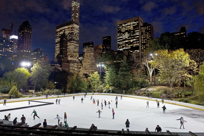 Ice skaters at Wollman Rink in Central Park