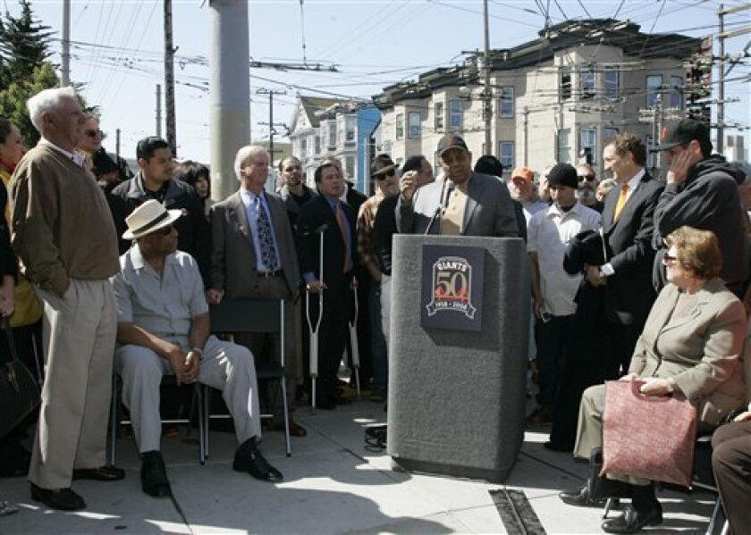 San Francisco Giants Hall of Famer Willie Mays, at podium, tells stories about his early playing days with the team during a ceremony to commemorate the Giants' 50th anniversary and the actual day Major League Baseball was first played on the West Coast, in San Francisco, Tuesday, April 15, 2008. The ceremony was held on the site where Seals Stadium once stood, which was the Giants' home their first two seasons. A plaque was unveiled to commemorate the game which was played on April 15, 1958. Looking on from left are, Giants former third baseman and manager Jim Davenport, Hall of Famer Orlando Cepeda, and Peter Magowan, team president and managing general partner.(AP Photo/Eric Risberg)
