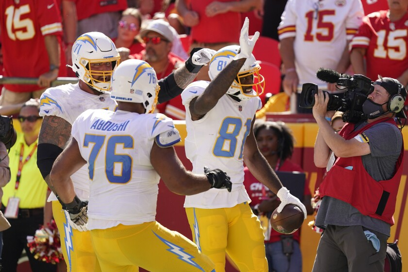 Los Angeles Chargers' Mike Williams (81) celebrates a touchdown reception during the second half of an NFL football game against the Kansas City Chiefs, Sunday, Sept. 26, 2021, in Kansas City, Mo. (AP Photo/Charlie Riedel)