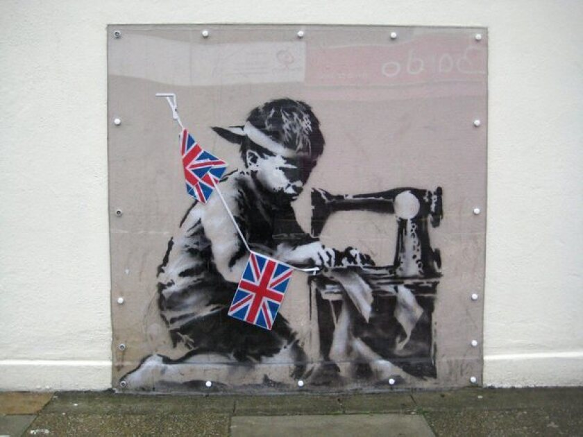 """""""Slave Labour,"""" by renowned street artist Banksy, sold at a London auction for $1.1 million."""