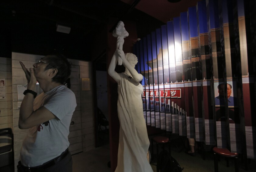 A man examines the exhibits in the June 4th Museum in Hong Kong on April 15, 2016.