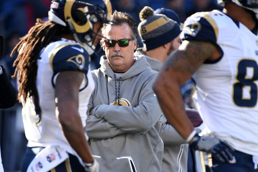 Rams Coach Jeff Fisher watches his players warm up before a game against the Patriots at Gillette Stadium on Sunday.