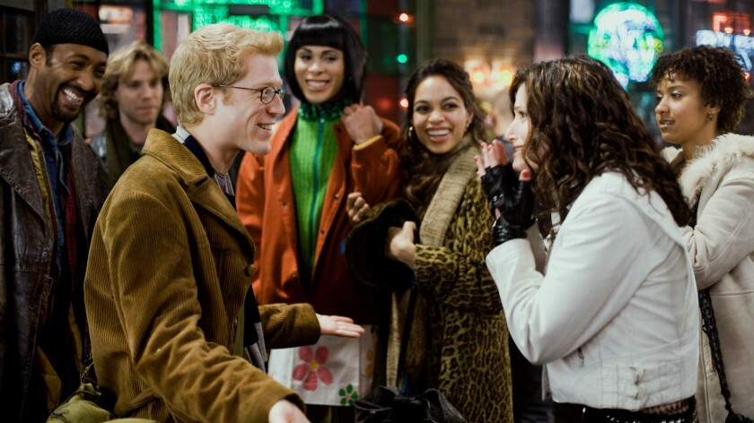 """Anthony Rapp, Idina Menzel and the cast in a scene from """"Rent."""""""