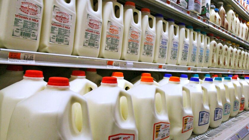 "Dairy farmers are struggling with ""deep cuts in income"" following a 40% drop in milk prices since 2014, members of Congress say."
