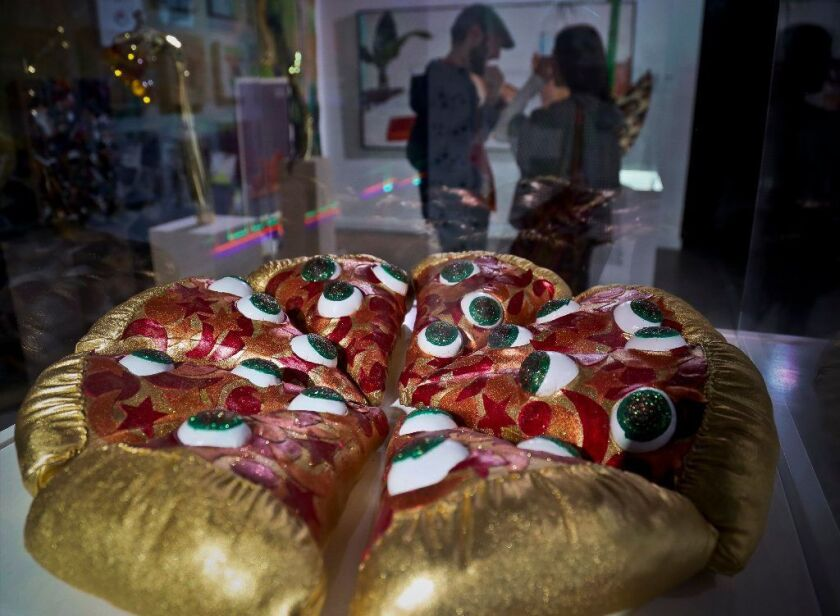 """A textile sculpture from artist Hein Koh called """"Mystic Pizza,"""" is part of a group art exhibition celebrating pizza at The Museum of Pizza in New York"""
