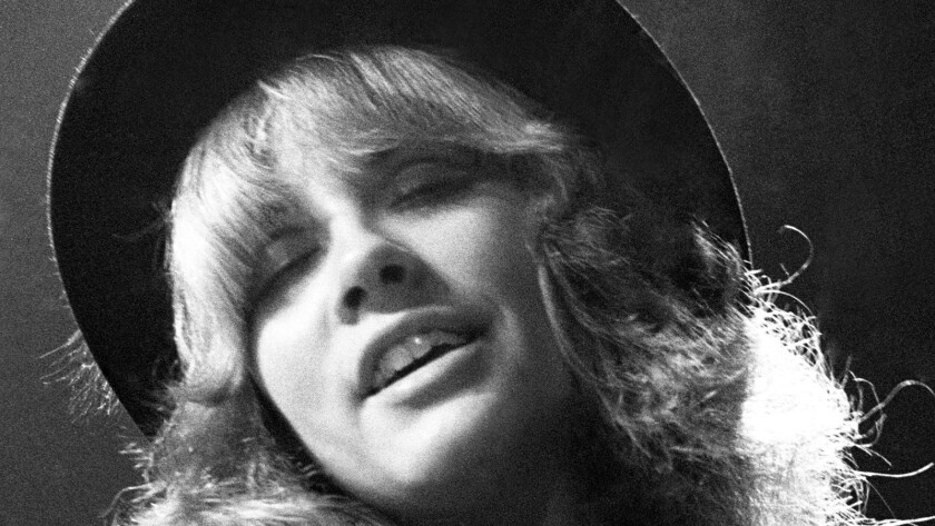 """Singer Stevie Nicks of the rock and roll group """"Fleetwood Mac"""" plays tambourine performs onstage in circa 1978."""