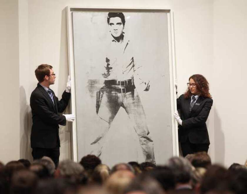 """Andy Warhol's """"Double Elvis"""" at Sotheby's auction in New York."""