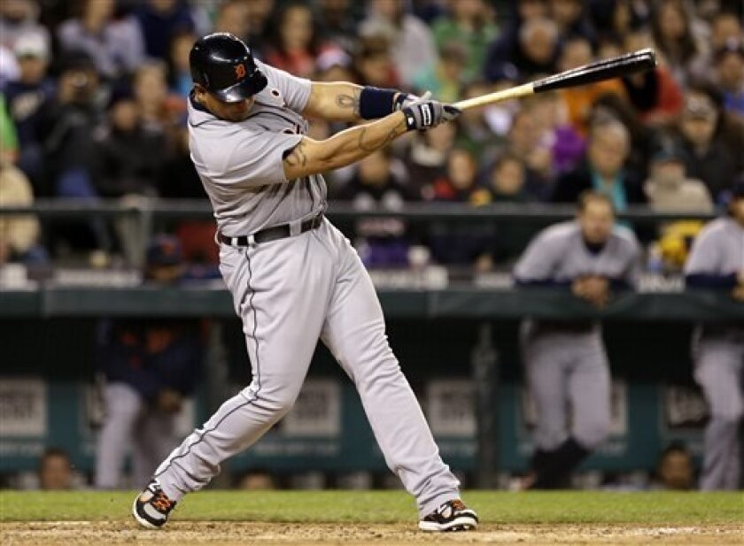 Detroit Tigers' Miguel Cabreran singles in a run against the Seattle Mariners in the seventh inning of a baseball game Tuesday, April 16, 2013, in Seattle. (AP Photo/Elaine Thompson)