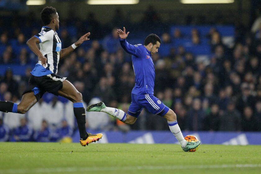 Chelsea's Pedro scores his side's second goal during the English Premier League soccer match between Chelsea and Newcastle United at Stamford Bridge stadium in London, Saturday, Feb. 13, 2016.  (AP Photo/Matt Dunham)