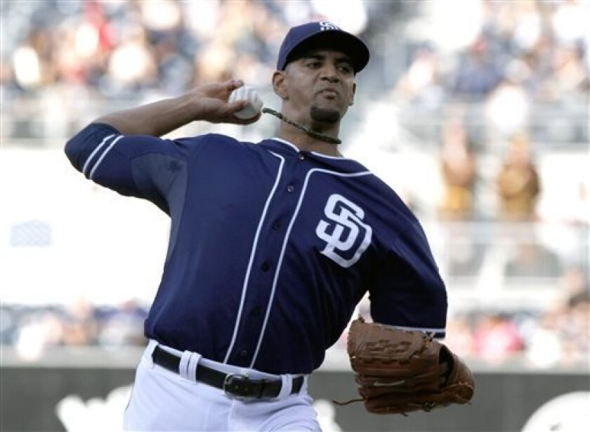 San Diego Padres  pitcher Tyson Ross delivers against the Colorado Rockies during the first inning of a baseball game on Saturday, Sept. 7, 2013, in San Diego. (AP Photo/Don Boomer)