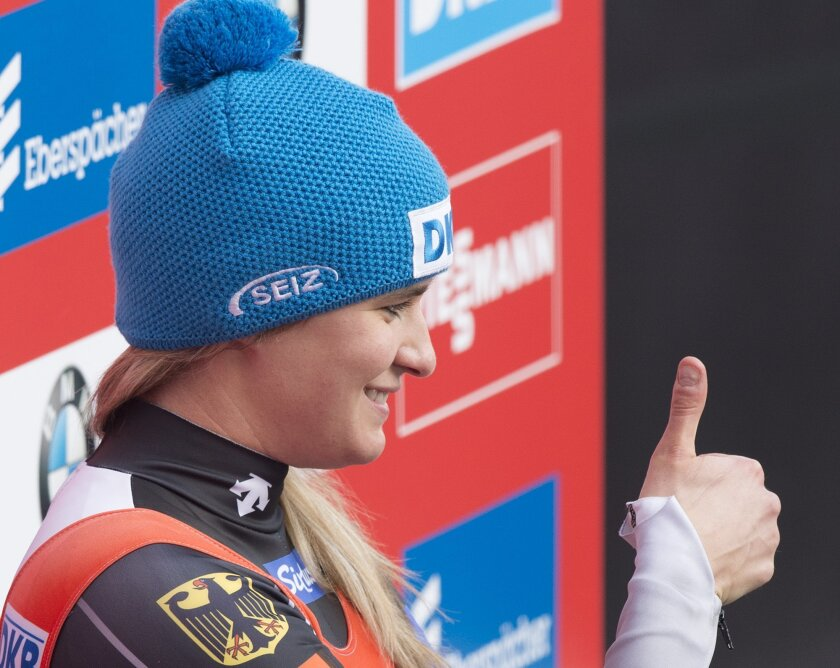Natalie Geisenberger of Germany gestures during the women's  luge World Cup race in Altenberg, eastern Germany, Sunday, Feb. 14, 2016. She leads the total World Cup standings. (AP Photo/Jens Meyer)