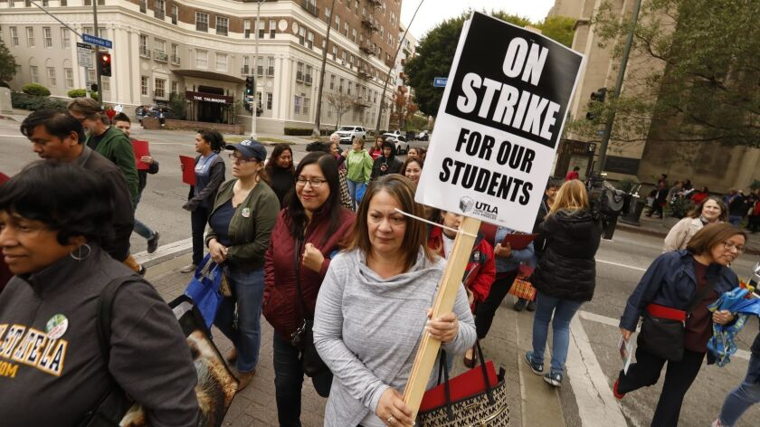 Alma Lucatero, a teacher at Nevin Elementary School, center, and other members of UTLA pick up materials for a possible teachers strike.