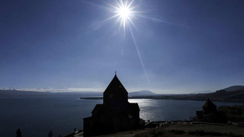 Tourists visit the Sevanavank monastic complex on the banks of Sevan Lake in Armenia.