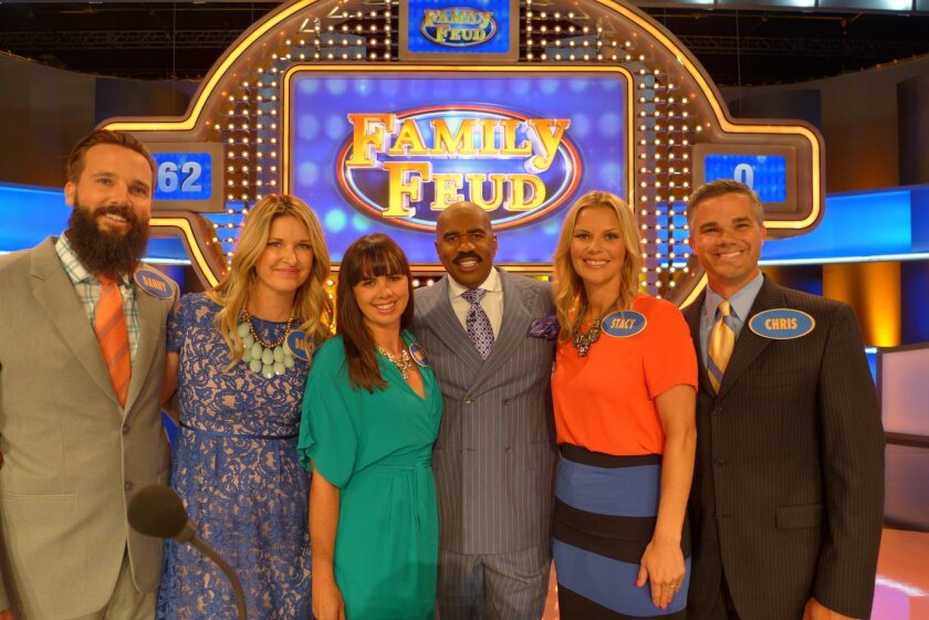 Dan Circuit, Darci Circuit, Mandy Circuit, host Steve Harvey, Stacy Circuit and Chris Circuit on the set of 'Family Feud.' Courtesy