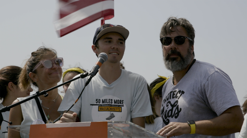 """David Hogg, center, with Patricia and Manuel Oliver, parents of Joaquin Oliver, in the documentary """"Parkland Rising."""""""