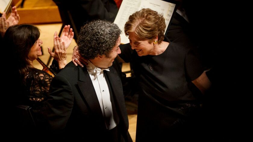 Deborah Borda shares a moment with Gustavo Dudamel during a farewell tribute to her in May 2017 at Disney Hall.
