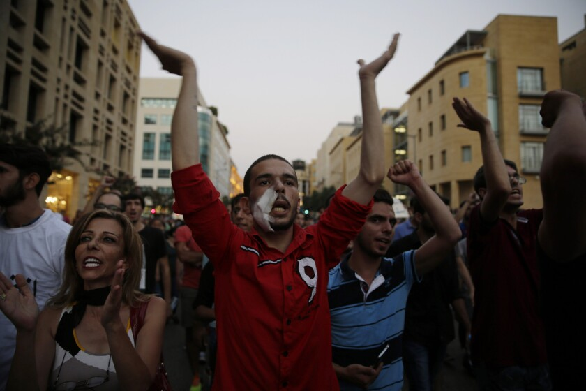 Lebanese activists chant slogans during a protest over uncollected trash and government ineptitude in downtown Beirut, on Aug. 26, 2015.