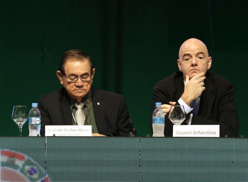 Antonio Carlos Nunes, recently elected vice-president of the Brazilian Football Confederation, left, and Gianni Infantino, general secretary of UEFA, attend an extraordinary session of Conmebol, the South American football federation, in Luque, Paraguay, Tuesday, Jan. 26, 2016. Representatives elected Paraguayan Alejandro Dominguez as their new president, replacing Angel Napout. (AP Photo/Cesar Olmedo)