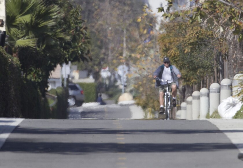 A cyclist heads south on a completed section of the Coastal Rail Trail that opened in Oceanside in 2014.