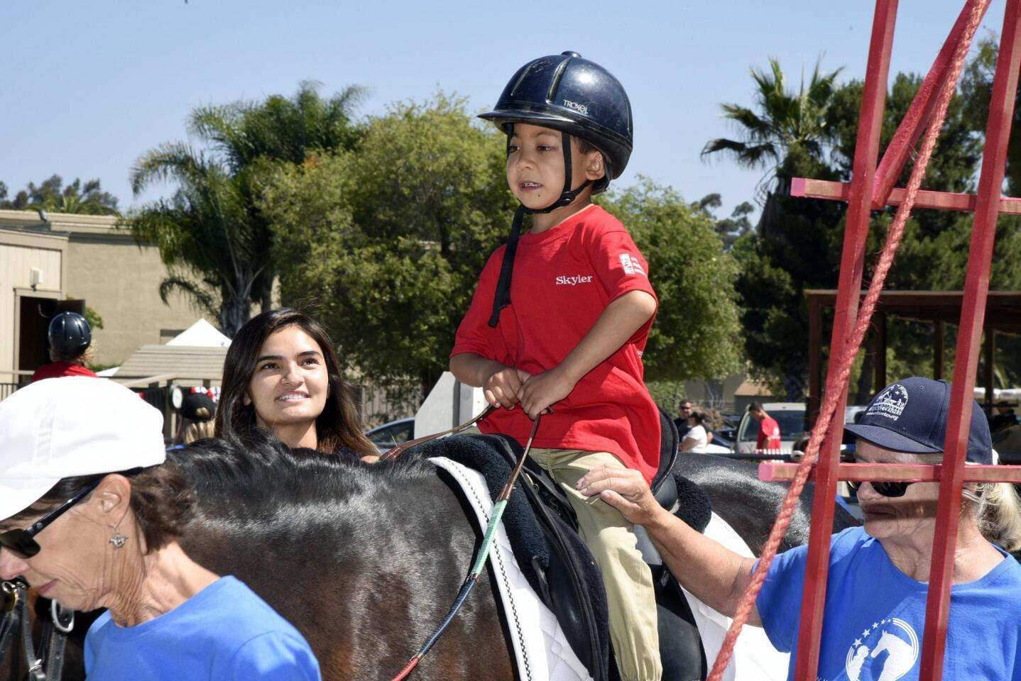 Students take spectators on 'A Summer Road Trip' at Helen Woodward Animal Center's 2018 Therapeutic Riding Show