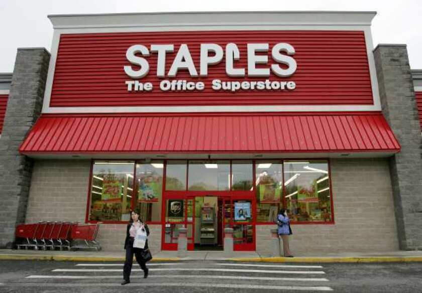 Staples to close stores, cut costs, boost online presence