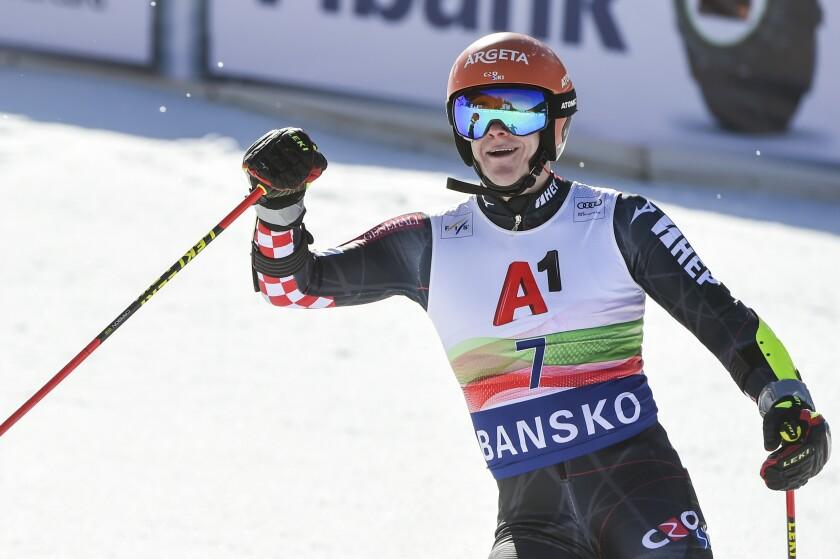 Filip Zubcic of Croatia celebrates in the finish area after winning an alpine ski, men's World Cup giant slalom, in Bansko, Saturday, Feb. 27, 2021. (AP Photo/Marco Tacca)